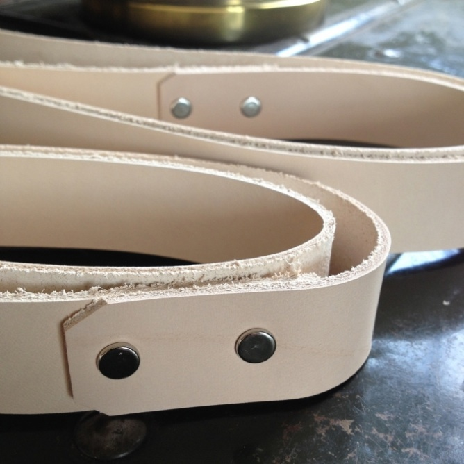 Unstained leather strapping